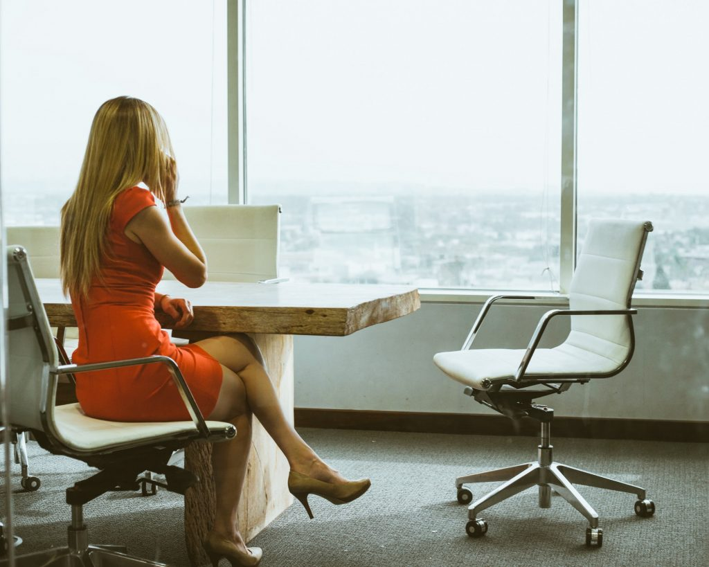 Business Woman In Conference Room Calling